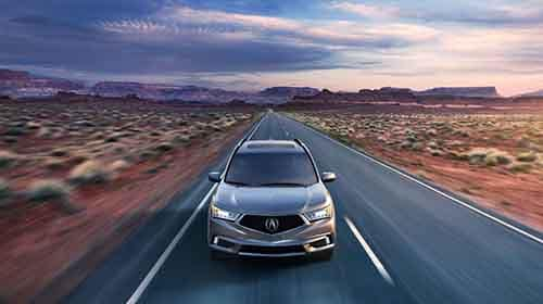 2018 Acura MDX driving through the desert