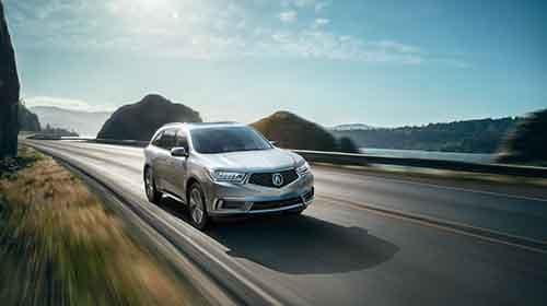 Acura MDX driving along water