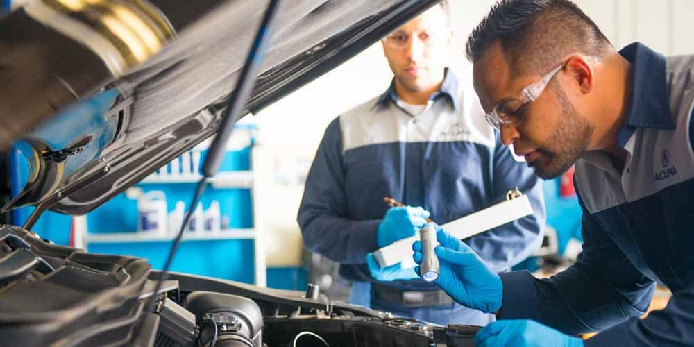 Acura Service Mechanic Fixing Car