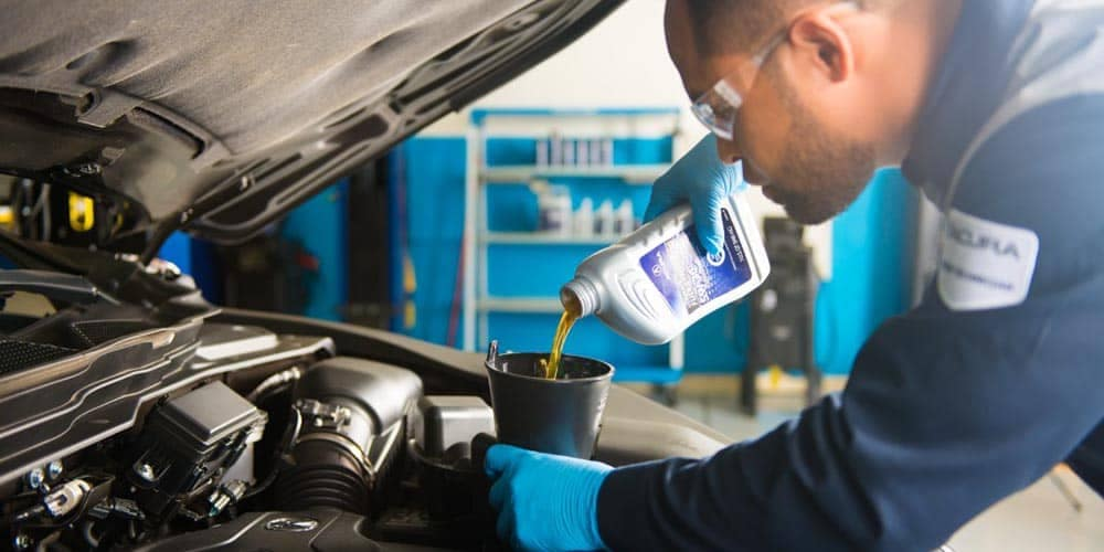 Acura Mechanic Changing Oil