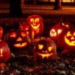 Lighted Carved Pumpkins at Night