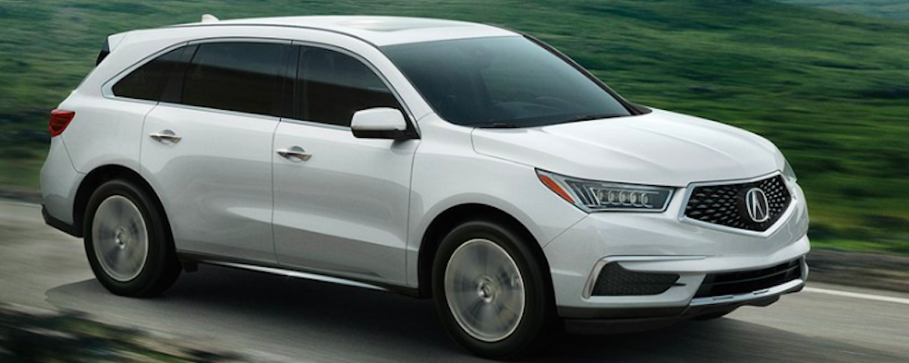 White 2019 Acura MDX Driving