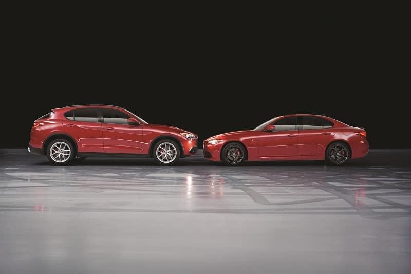 New Alfa Romeo Stelvio and new Alfa Romeo Giulia parked facing each other