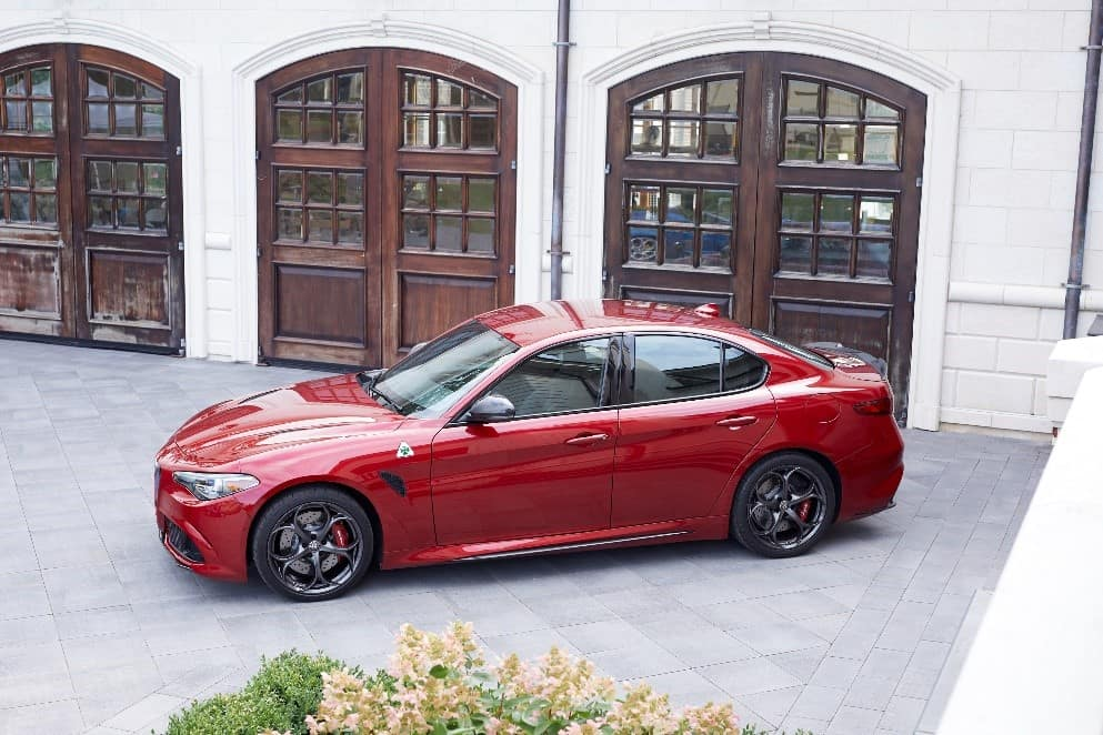 Red 2019 Alfa Romeo Giulia Quadrifoglio parked in front of building