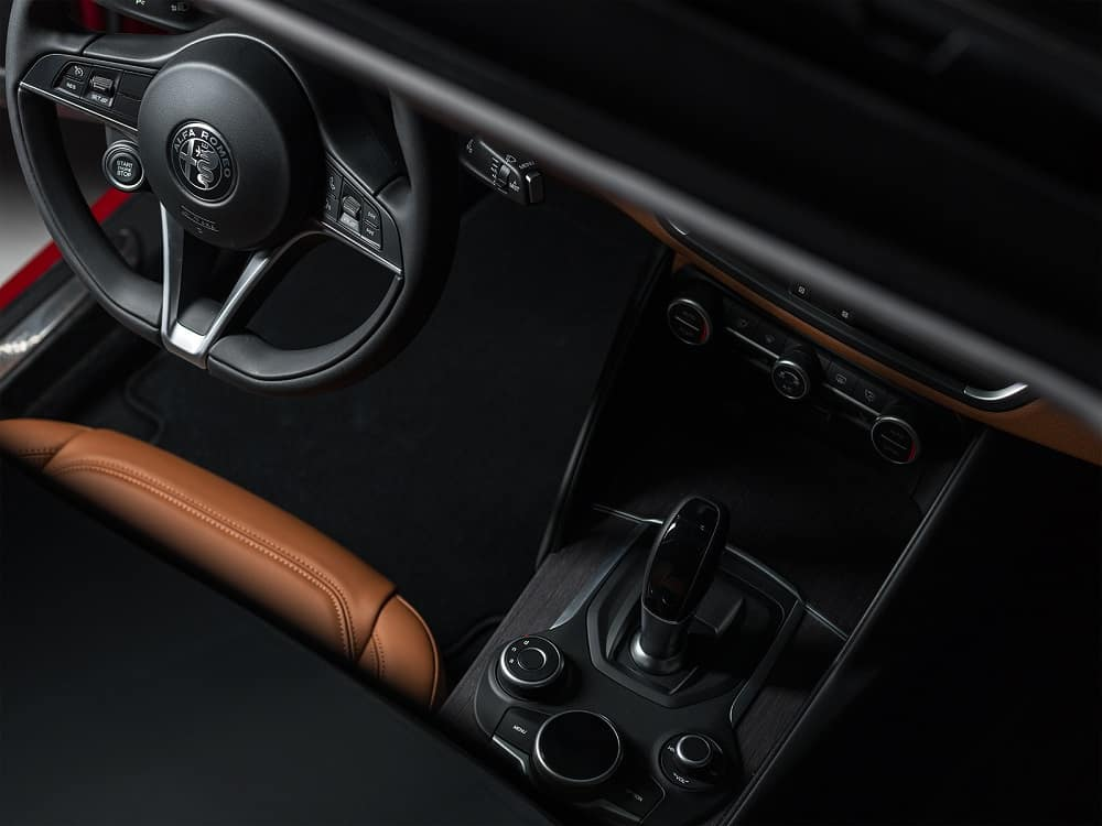 interior of Alfa Romeo Giulia Ti with tan leather seats and black console
