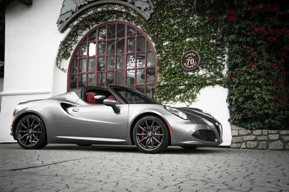 gray 2020 alfa romeo 4C Spider two-door luxury sportscar parked in front of white building with green vines
