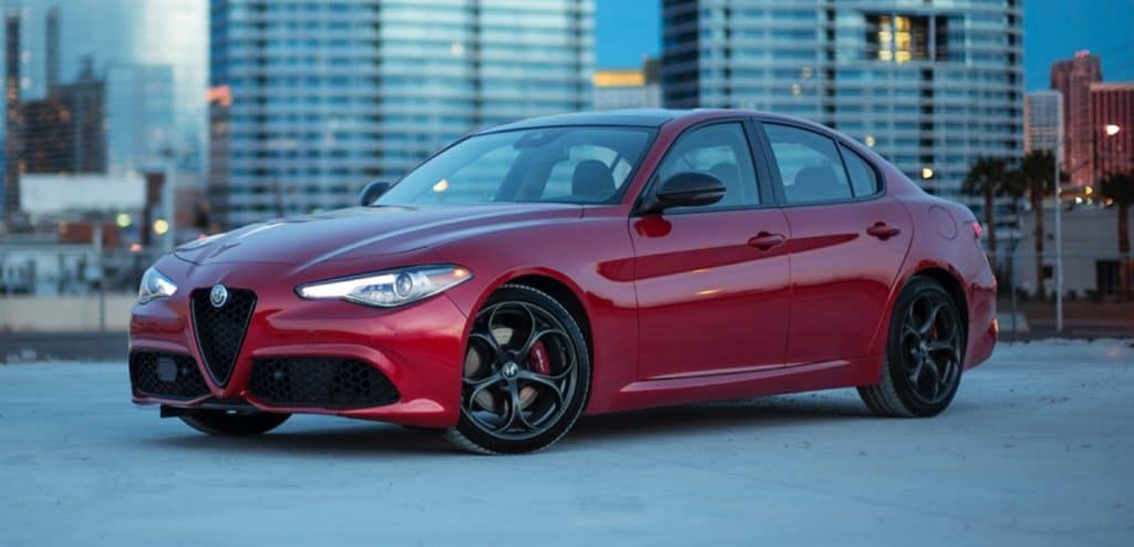 red 2020 Alfa Romeo Giulia parked with city in background