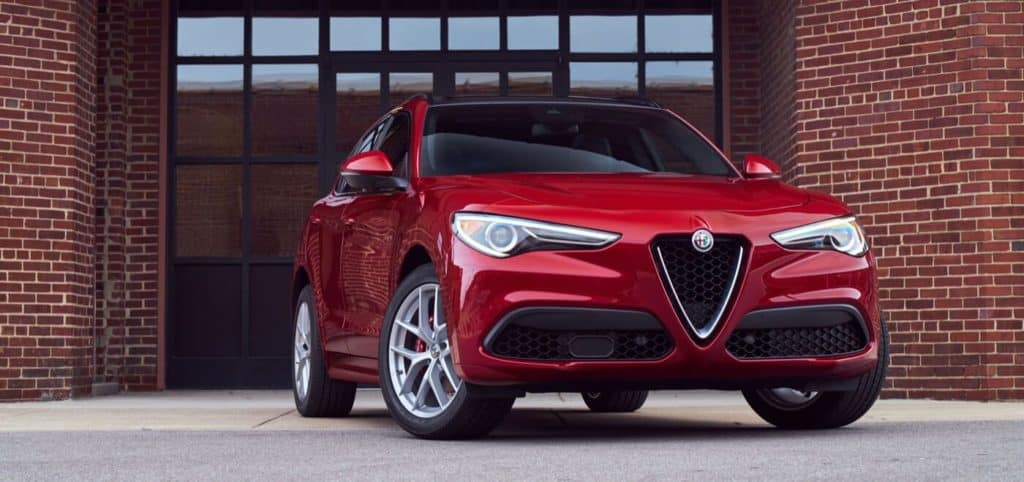 red 2020 Alfa Romeo Stelvio luxury SUV parked in front of building