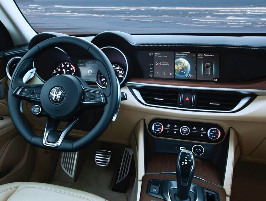 Cream SUV interior with dark brown wood accents in a 2020 Alfa Romeo Stelvio