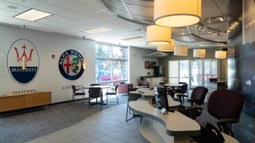interior of the Alfa Romeo of Albany and Maserati dealership showing desks and chairs where clients can learn about the different finance options
