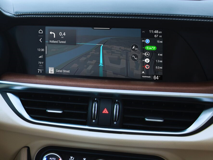 closeup image of the updated infotainment center dashboard console in the 2020 Alfa Romeo Stelvio SUV displaying turn-by-turn navigation