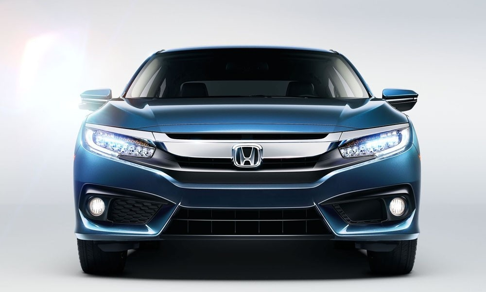 2017 Honda Civic showing the sleek LED headlights and fog lights available on the Civic Touring.