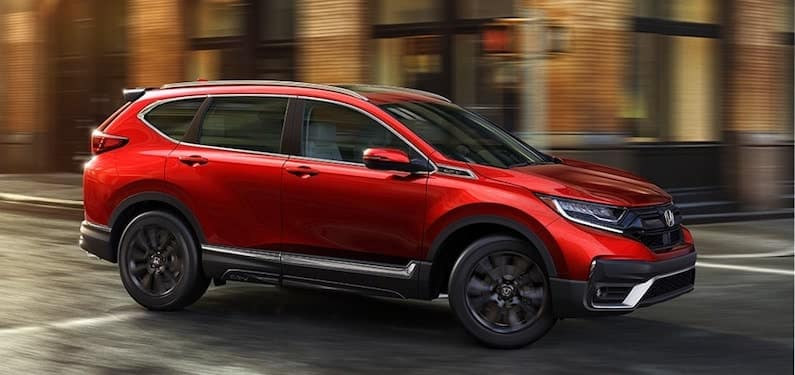 The 2020 Honda CR-V Touring shown in Radiant Red Metallic with Honda Genuine Accesories