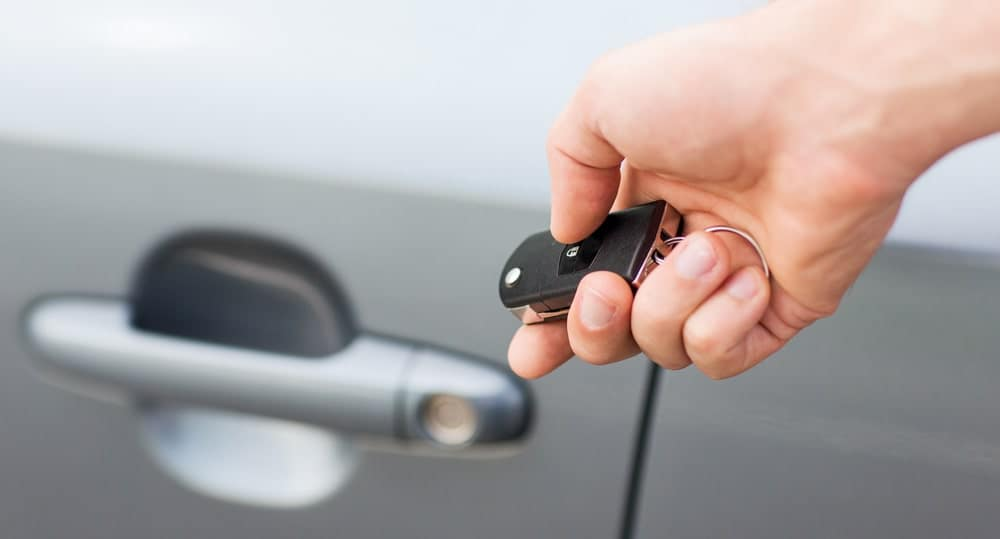 Holding Key Fob Out Next To A Car Door