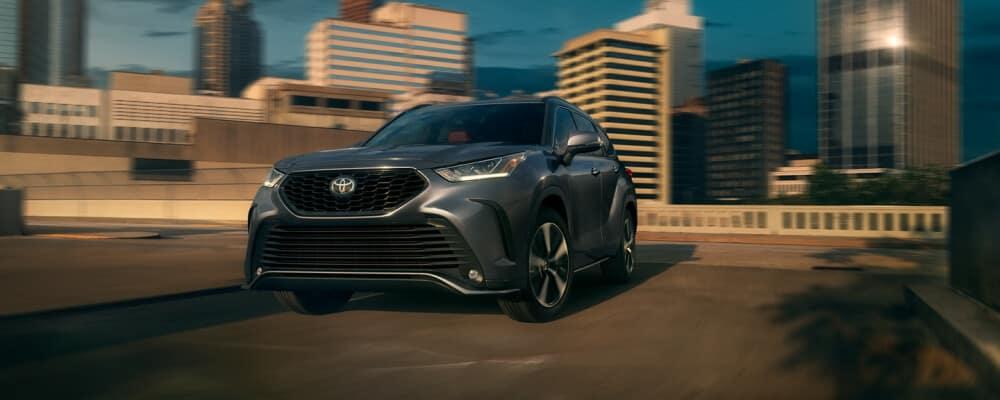 2021 Toyota Highlander driving during sunset