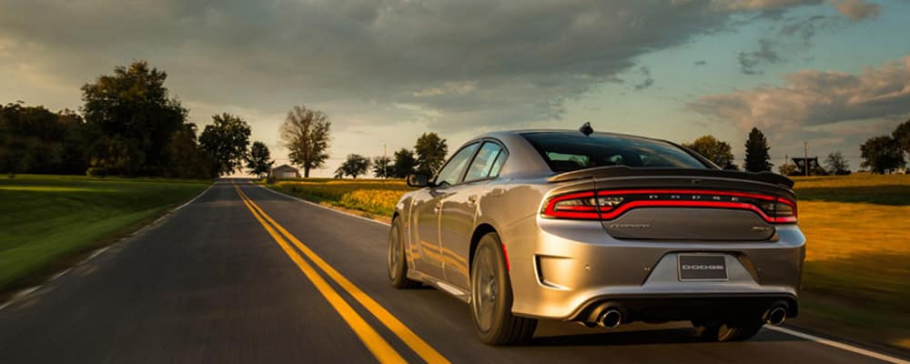 2018 Dodge Charger driving on a country road banner