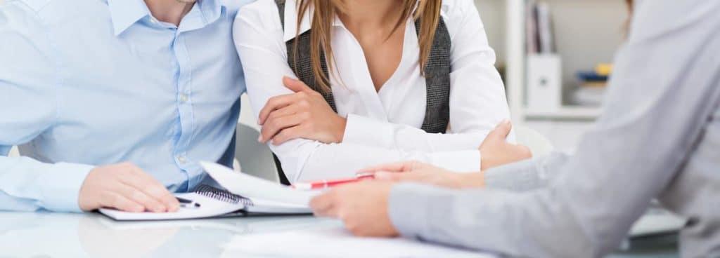 Man and woman filing paperwork