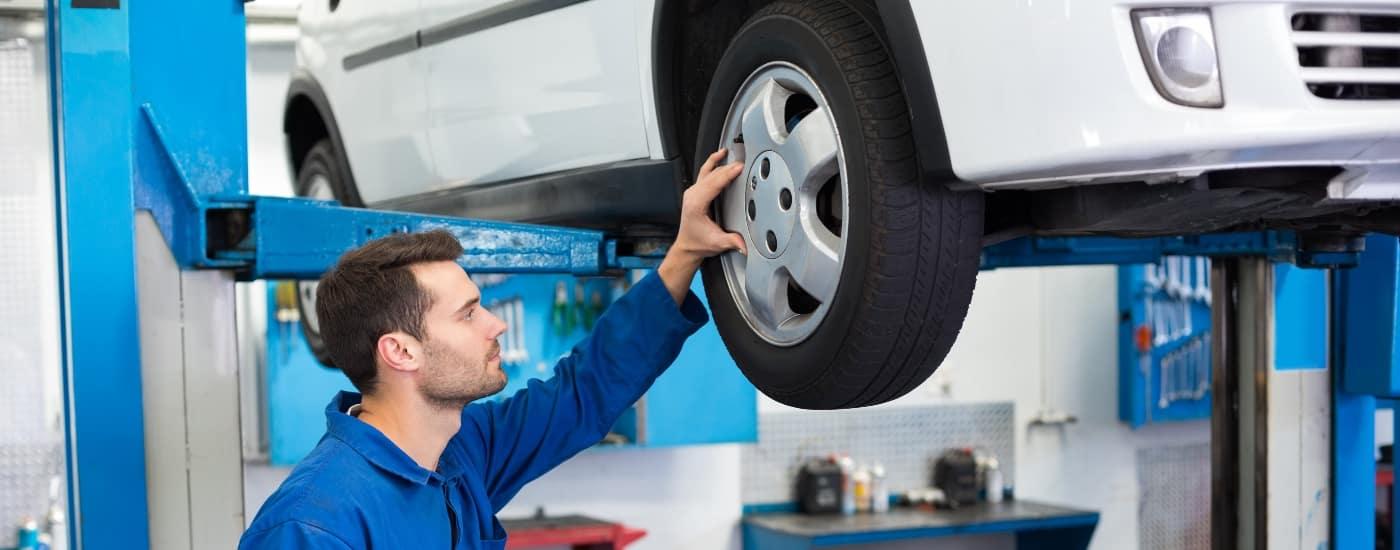 man examining tires