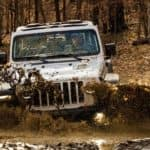 jeep wrangler riding through mud