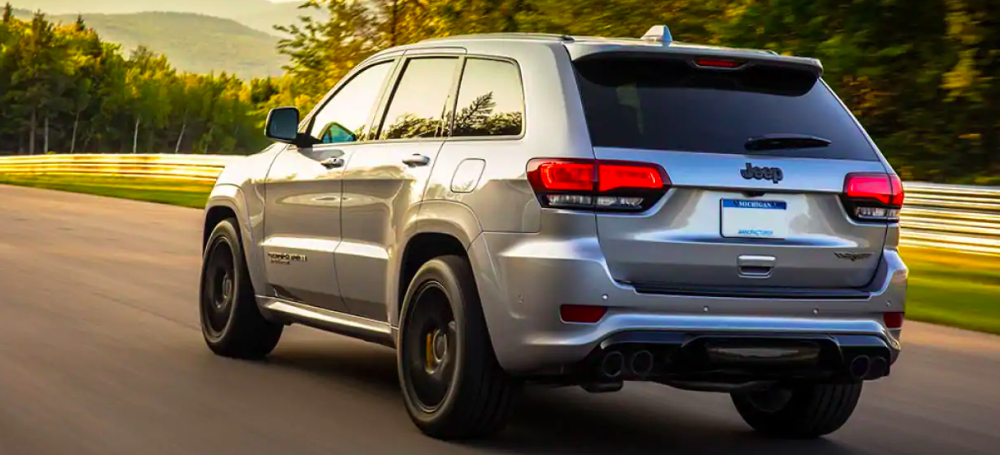2019 Jeep Grand Cherokee driving at sunset