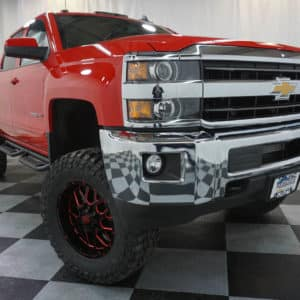 Red Silverado HD Lifted Truck