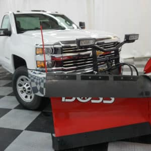 White Silverado with Red Plow Attachment
