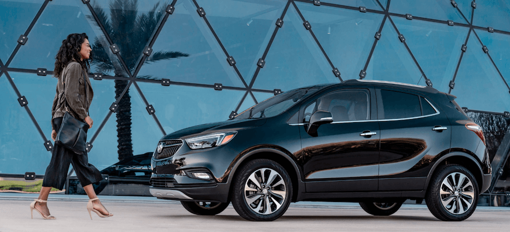 2020 buick encore with woman walking near geodesic dome