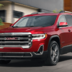 2020 GMC Acadia driving on highway