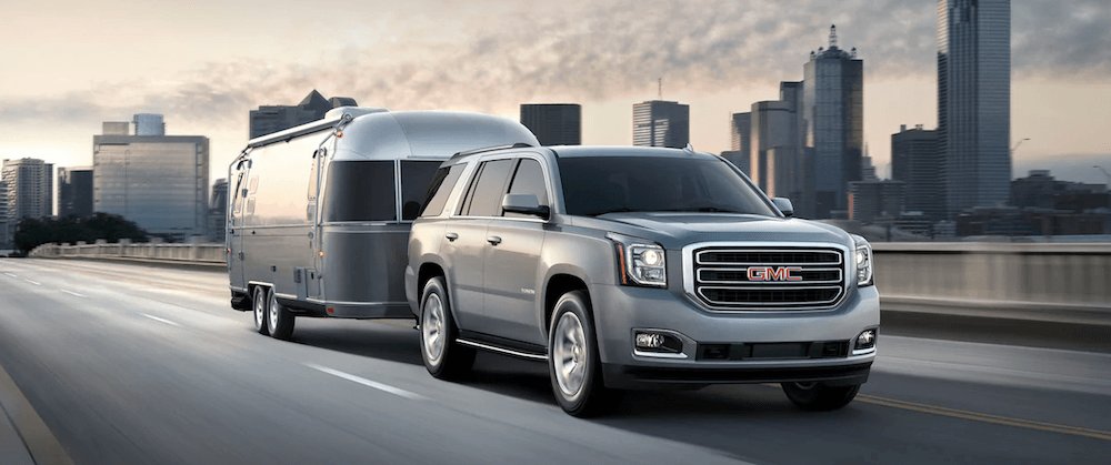 2020 GMC Yukon towing a trailer on city highway
