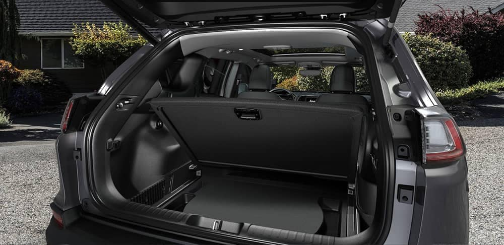 View of Jeep Cherokee cargo space with trunk open
