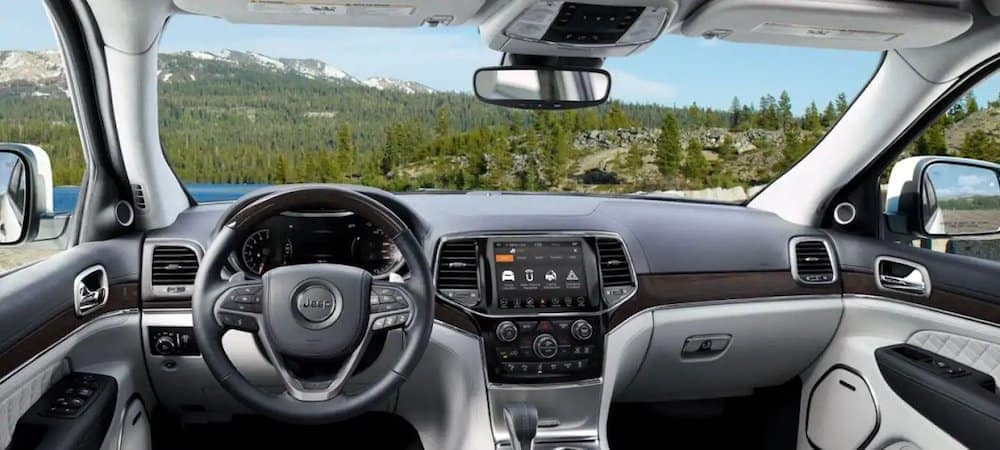 View from inside 2019 Jeep Grand Cherokee driver's seat looking at green mountainside