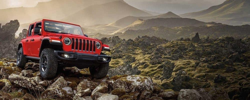 Red 2020 Jeep Wrangler off road in mountains