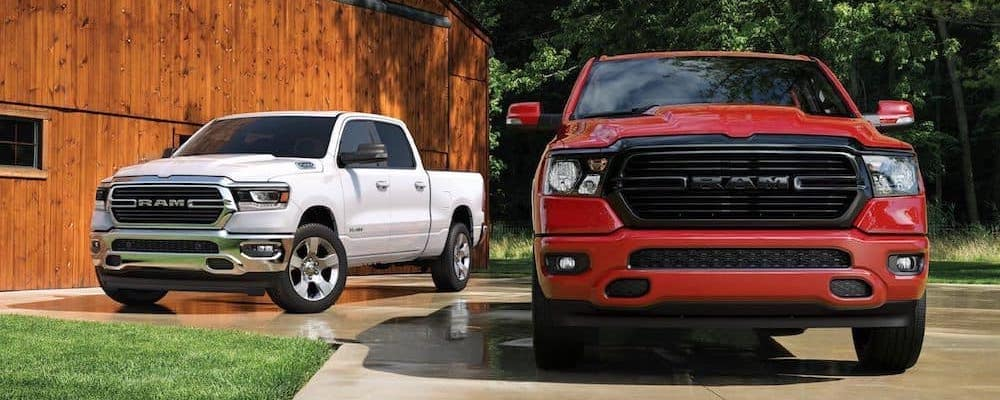 Red 2020 RAM 1500 parked in front of white 2020 RAM 1500