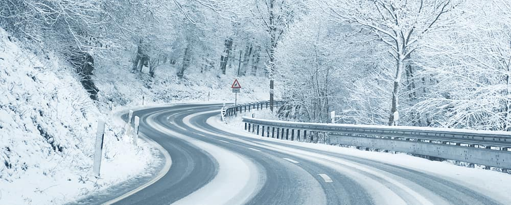 snow covered winding road
