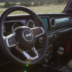 2019 Jeep Wrangler interior with steering wheel and dashboard