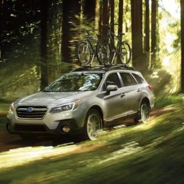 2018 Subaru Outback Exterior driving through forest
