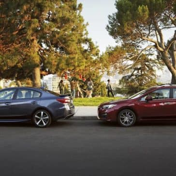 2019 Subaru Impreza Sedan and 5-Door Models Parked at a Park