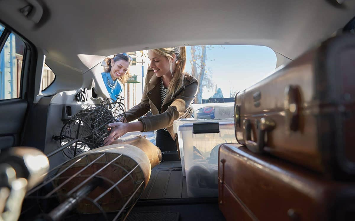 Girls Loading Cargo Area of a 2019 Subaru Crosstrek