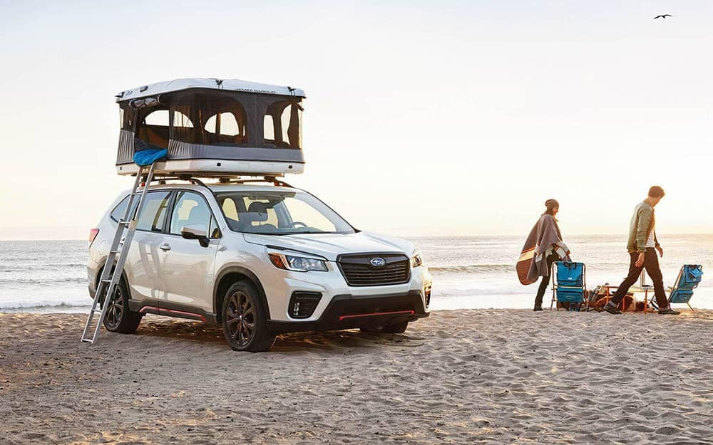 2019 Subaru Forester Parked at Beach with Pop Up Tent on Roof Rails