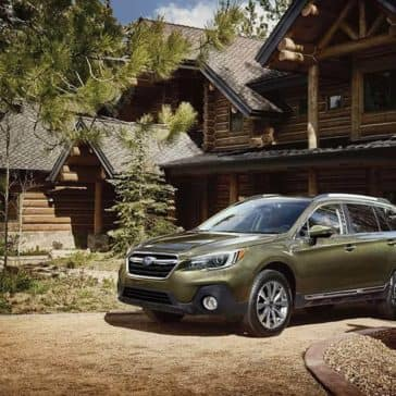 2019 Subaru Outback Parked Outside Log Cabin Home