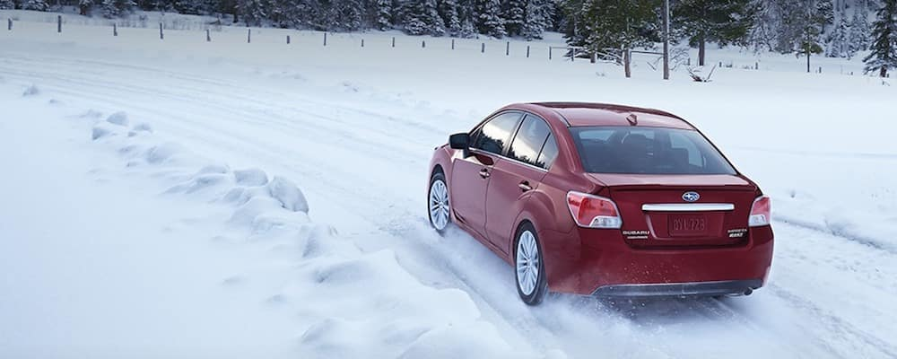 Subaru Impreza sedan with AWD in the snow