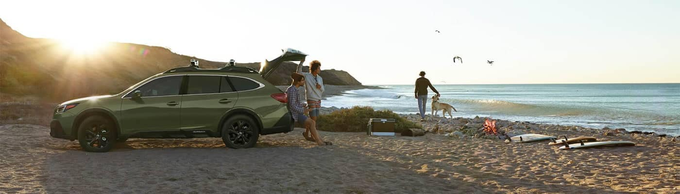 Subaru Outback parked on beach