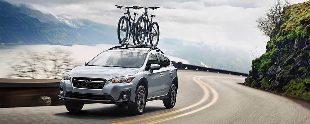 Subaru Crosstrek Driving with Bikes on Roof Rails