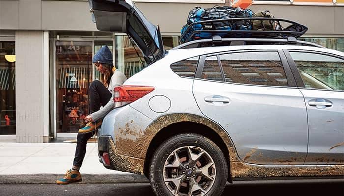 Subaru Crosstrek Parked with woman sitting in cargo area