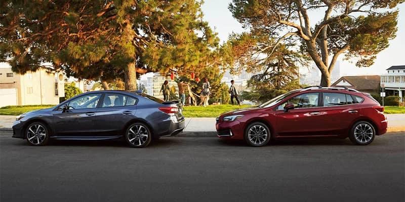 Subaru Impreza Models Parked by a Park