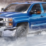 Chevrolet Silverado driving in snow