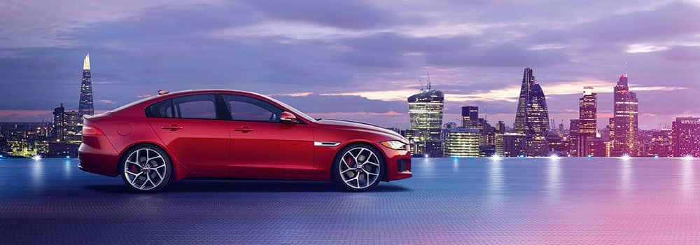 2018 Jaguar XE Parked with City in the Background