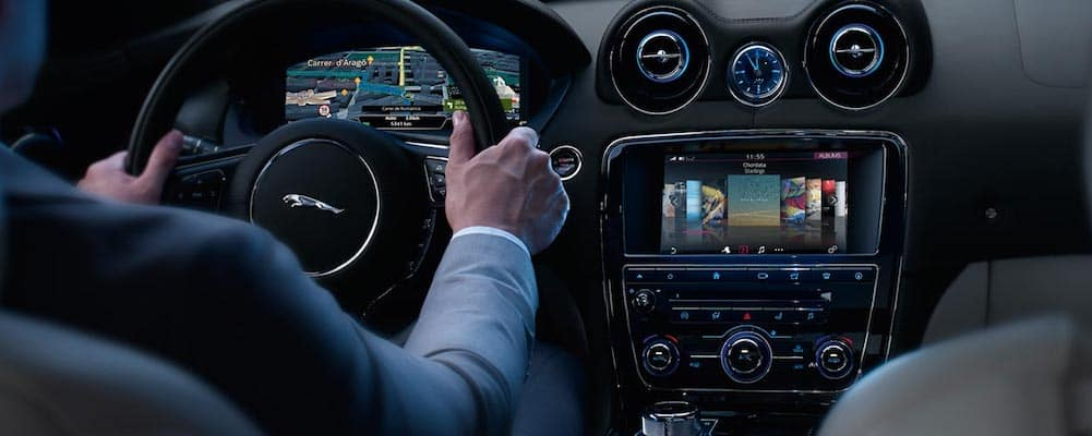 Jaguar interior with driver using Jaguar incontrol apps