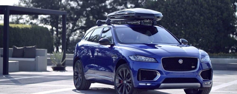 blue 2019 jaguar f-pace with roof bars and roof box