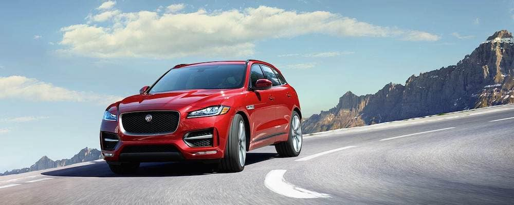 2019 Red Jaguar F-PACE Front View driving on snowy mountain highway